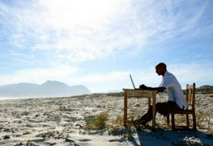 man-laptop-beach_large-300x205